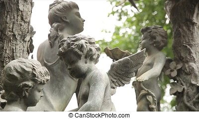 Garden statue vintage close-up. Sleeping Angel at La...