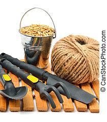 Garden supplies, wheat grains, rake, pot, shovel