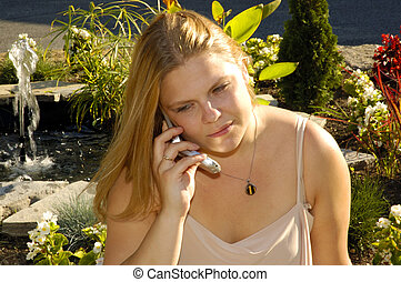 Garden Talk - Pretty Blond Speaking on a Cellphone in a...
