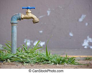 Garden tap saving water. Faucet concept