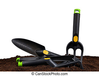 Garden tools in soil. - Garden tools in soil isolated on a...