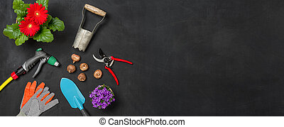Garden tools on a dark background with copy space