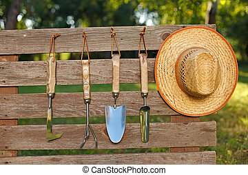 Garden tools on board fence