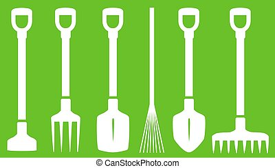 garden tools on green background