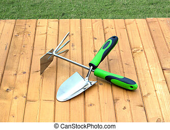 Garden tools on wooden surface