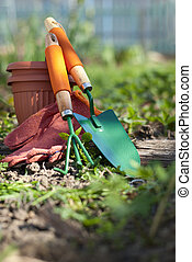 garden tools - shovel, fork, gloves and clay pots in the ...