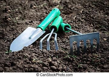 Garden tools, shovel, scoop, rake, villas lie on the soil, ...