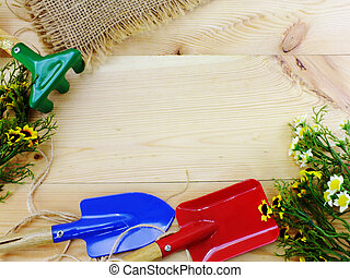 garden tools with space copy on wooden background