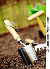 Garden trowel in soil - Metallic silver garden trowel ...