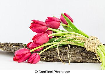 Garden tulips tied with raffia