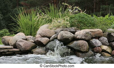 Garden waterfall by the pond