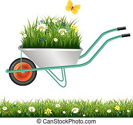 Garden Wheelbarrow And Grass With Flowers
