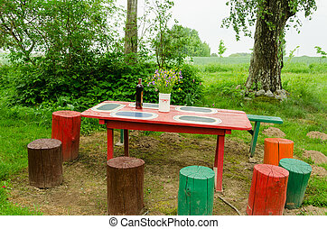 garden wooden table bunch flowers colorful stumps