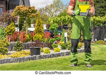 Garden Worker with Handheld Seeder