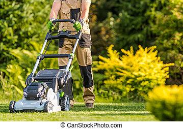 Garden Worker with Lawnmower Cutting Grass