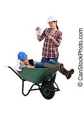 Gardener asleep in a wheelbarrow