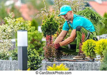 Gardener Finishing Garden
