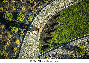 Gardener in Newly Build Backyard Garden