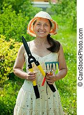 gardener in with garden tools