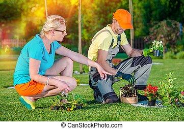Landscaper Working with Client - Gardener Landscaper Working...