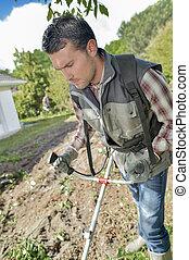 Gardener plowing