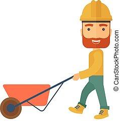Gardener pushing a wheelbarrow. - A male gardener wearing...