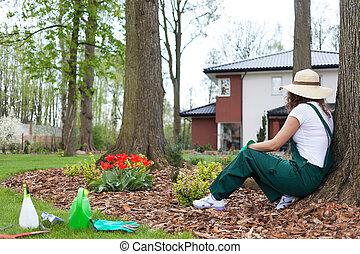 Gardener resting after work