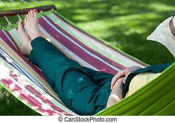 Gardener resting on hammock