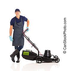 gardener standing next to lawnmower