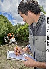 gardener taking notes