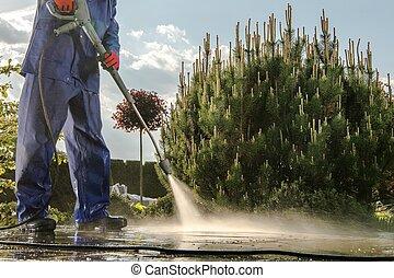 Gardener Washing Garden Paths