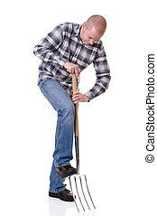 Gardener with a hayfork