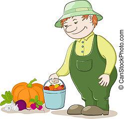 Gardener with crop vegetables