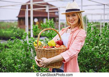 Gardener with fresh vegetables