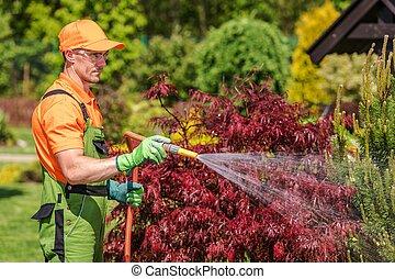 Gardener with Garden Hose
