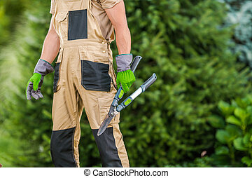Gardener with Garden Scissors in His Hand