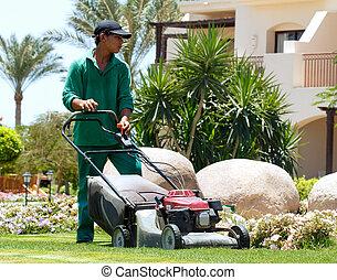 Gardener with lawn mower