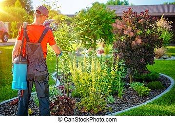 Gardener with Pests Spray. Spring Work in Garden.