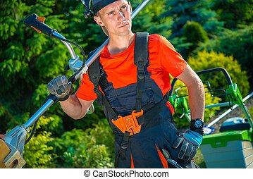 Gardener with Shoulder Mower