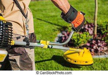 Gardener with String Trimmer