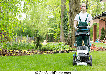 Gardener with the lawn mower