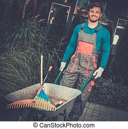 Gardener with tools in garden