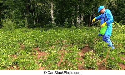 gardener work field - Gardener man in waterproof workwear...