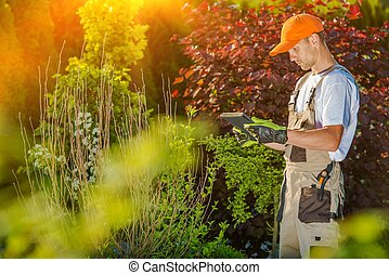 Gardener Working on Tablet