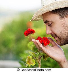 Gardener - Young male gardener working in the garden