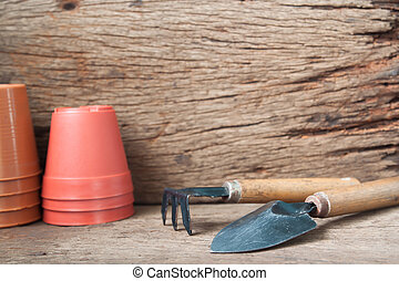 Gardener's desk, garden tools and pottery on wooden, Hobby and lifestyle concept