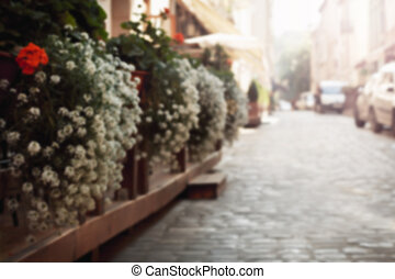 gardening at the street outside a restaurant. Blurring background