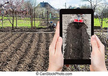 farmer photographs the plowing of garden ground - gardening...