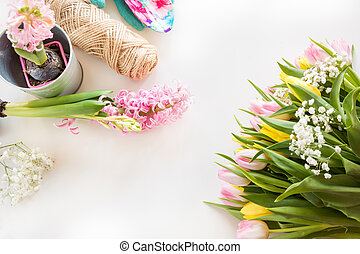 Gardening concept. Still life of seedling hyacinth, garden tools, scissors, twine, tubers-bulbs gladiolus with copy space. Top view. Spring.