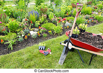 Gardening equipment ready for use in a garden with beautiful...